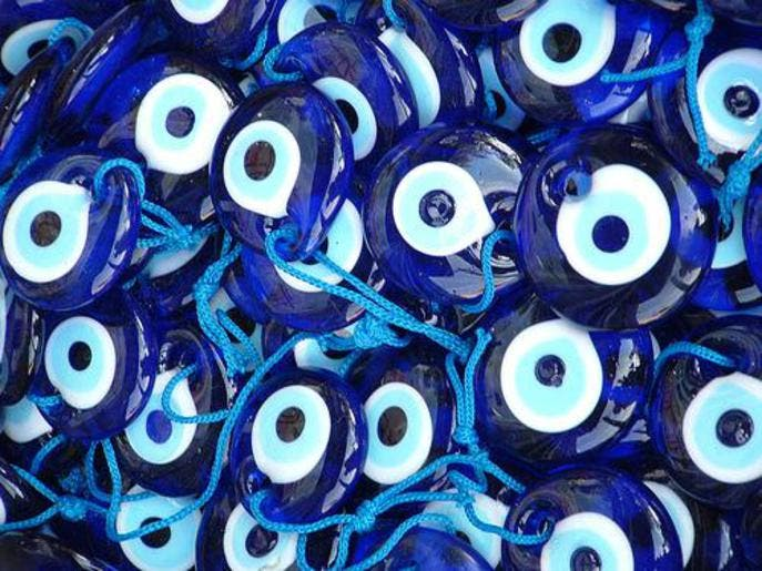 "For designer Aksu, the colors of the ""evil eye"" amulet – indigo ..."