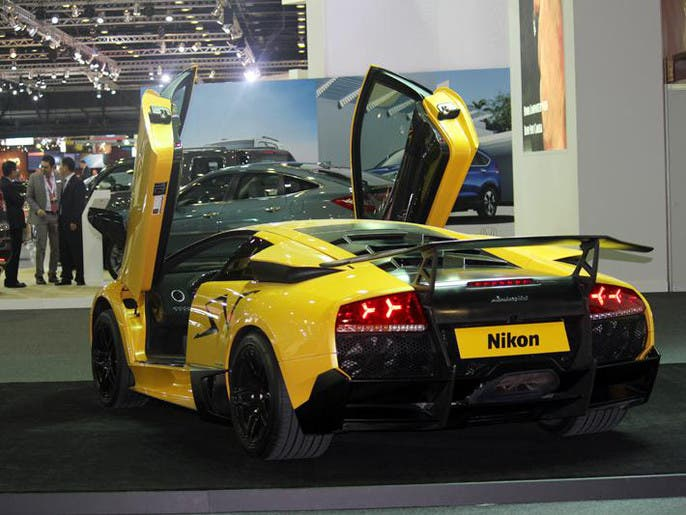 4f5f20f6 7457 4f4b 8a66 289a297cc5c9 4x3 690x515 صور معرض دبي الدولي للسيارات 2013 فى مركز التجارة العالمي بدبي من 5 11 2013 الى 9 11 2013