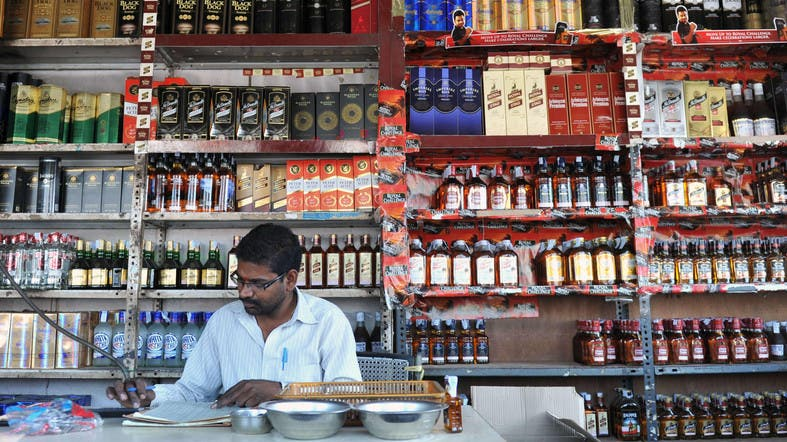 down stock at an alcohol store in Hyderabad. Authorities in Kerala ...