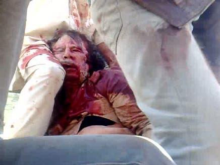 جثة معمر القذافي