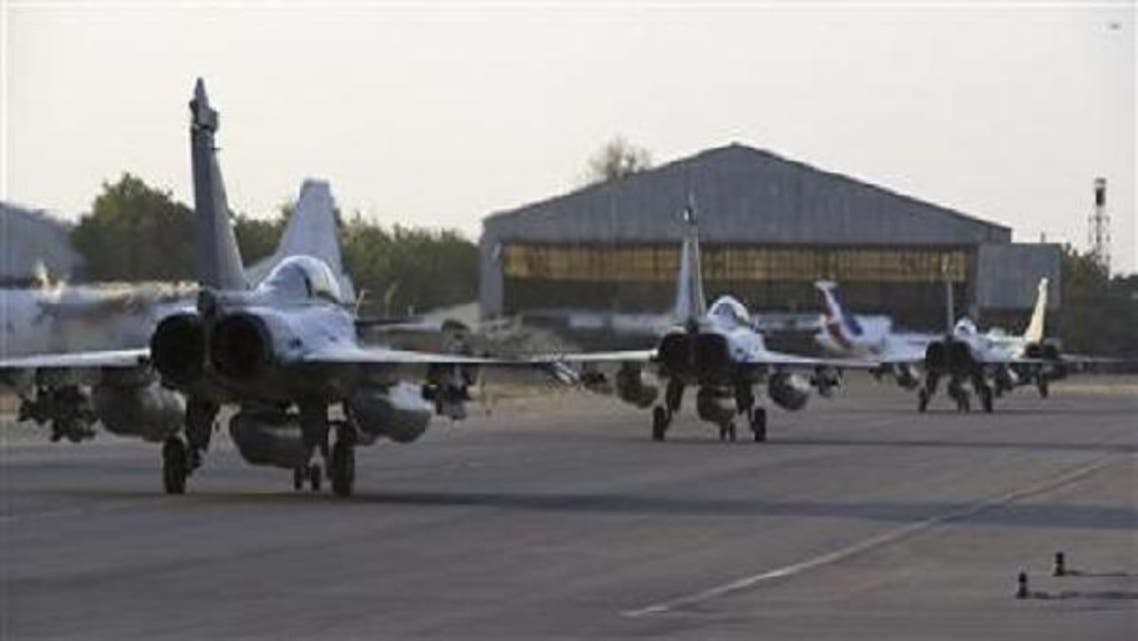 French Rafale fighter jets taxi on the runway after landing in Ndjamena, Chad before their deployment in Mali. (Reuters)