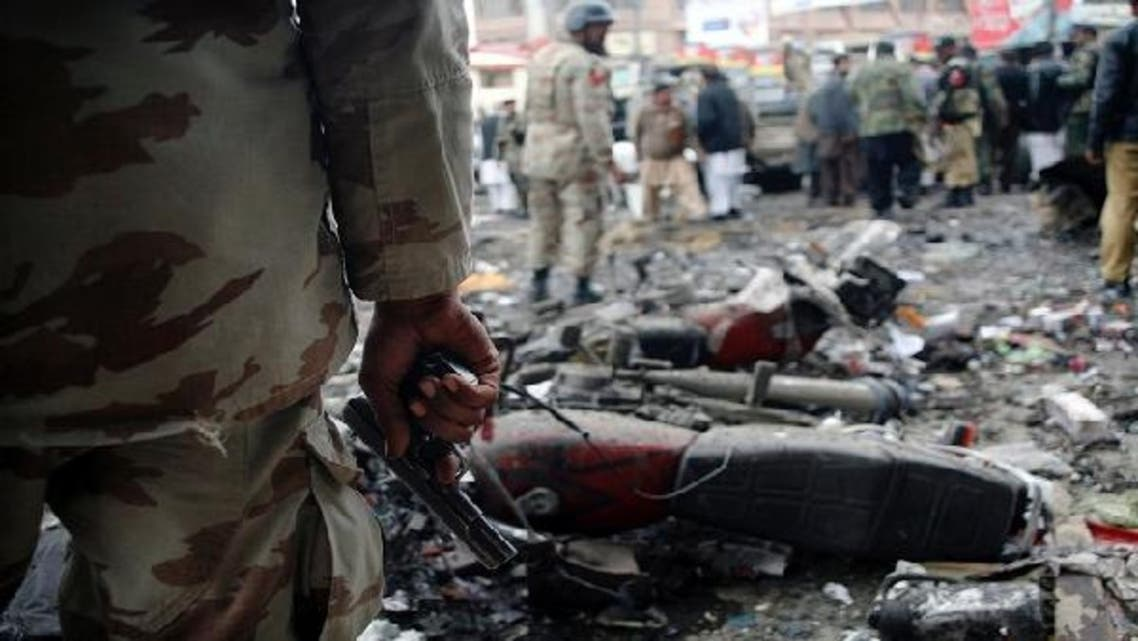 A paramilitary soldier stands guard at the scene of a bomb explosion in Quetta January 10, 2013. (Reuters)