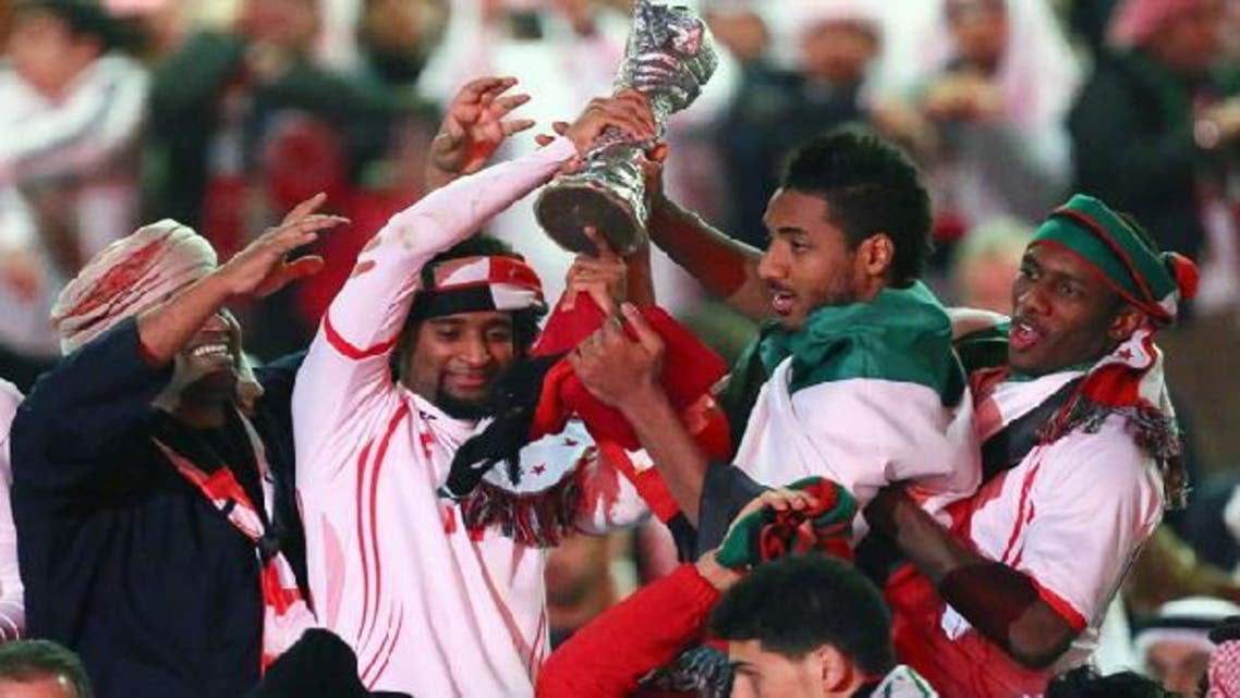 Emirati players celebrate with their trophy after winning the final of the 21st Gulf Cup on Jan. 18, 2013 in Manama. (AFP)