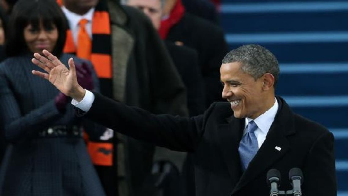 U.S. President Barack Obama waves during the public ceremonial inauguration on the West Front of the U.S. Capitol January 21, 2013 in Washington, DC. (AFP)