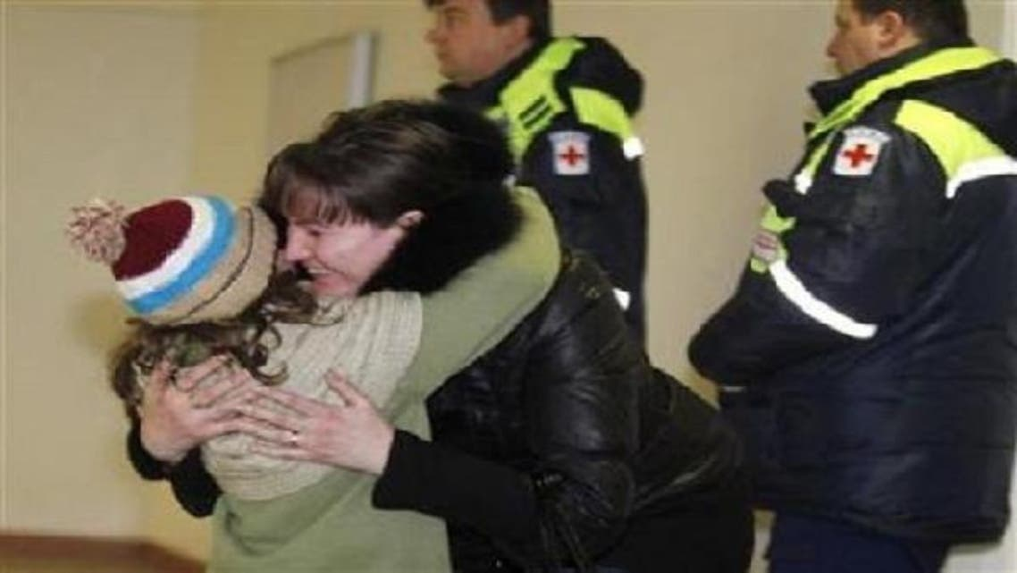 A woman hugs her daughter, who was a passenger on a Russian Emergencies Ministry flight from Beirut, after her arrival at Moscow\'s Domodedovo airport. (Reuters)