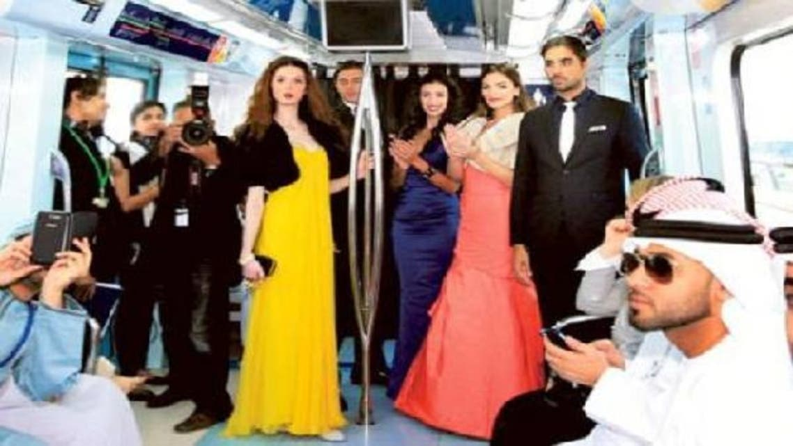 Models display Bloomingdales news collection at a special fashion catwalk on a moving Metro train in Dubai. (Photo Coutesy: Gulf News)