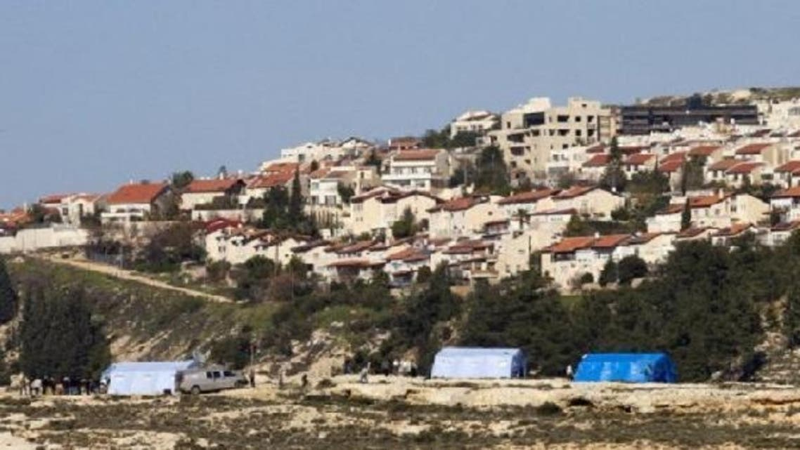 Palestinian protesters gather next to tents erected in the West Bank village of Beit Iksa on Jan. 19, 2013. Some 200 Palestinians grouped at a new campsite in a West Bank village on Saturday, protesting for the second consecutive day against Israel's intention to confiscate land. (AFP)