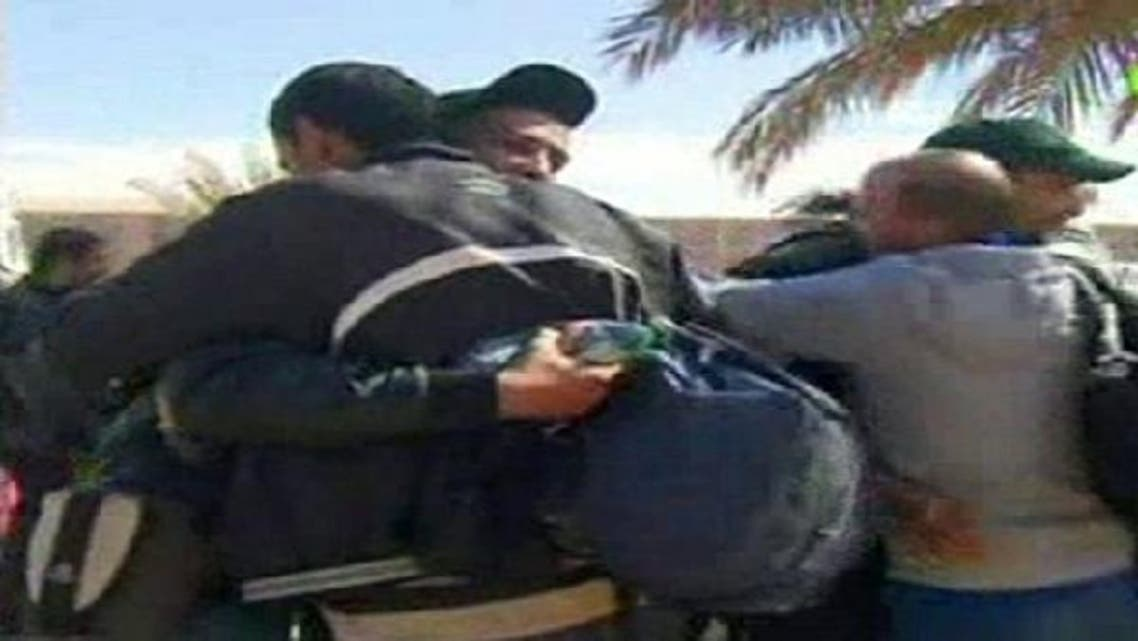 Hostages react after they were freed from a gas facility in Algeria where Islamist militants were holding them in Tigantourine.About 60 foreigners were still being held hostage or missing inside a gas plant on Friday after Algerian forces stormed the desert complex to free hundreds of captives taken by Islamist militants. (Reuters)
