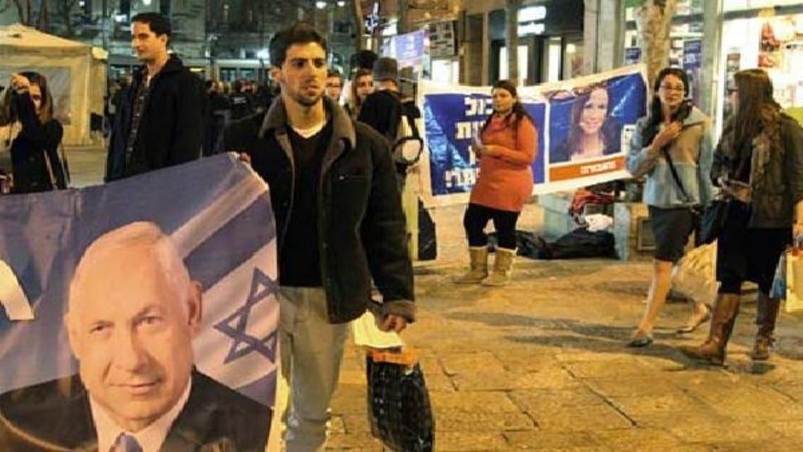 اسرائیل میں پولنگ سے 24گھنٹے قبل سیاسی جماعتوں کے کارکنان انتخابی مہم چلا رہے ہیں۔