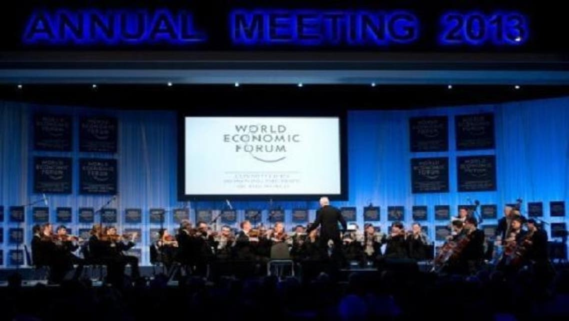 An orchestra plays at the opening ceremony of the World Economic Forum (WEF) at the congress center at the Swiss resort of Davos, on Jan. 22, 2013. (AFP)