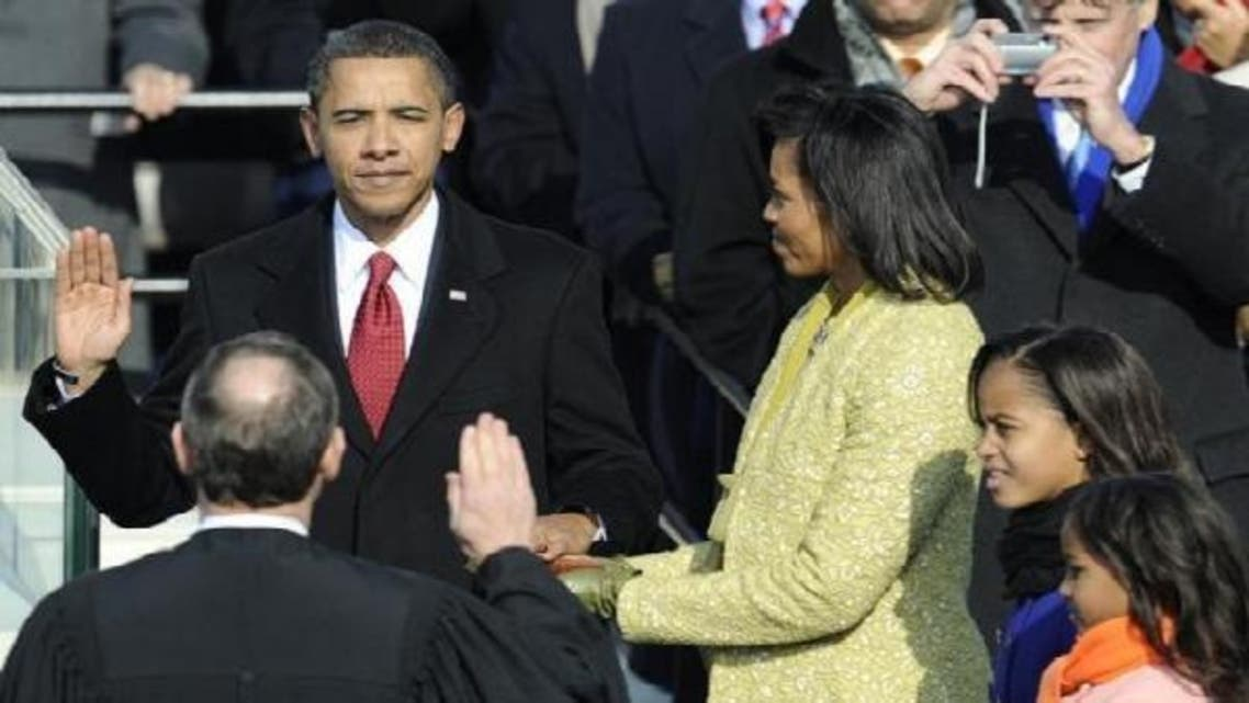 President Barack Obama took the oath of office with his family by his side and using his wife\'s family bible. (AFP)