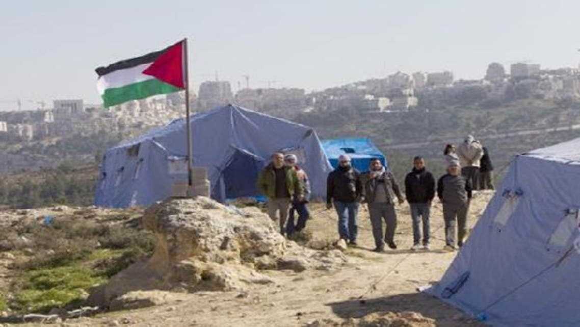 About 100 activists and organizers of the Bab al-Karama initiative staged a protest against confiscation of Palestinian land by Israeli forces. (Photo of Felesteen.ps)