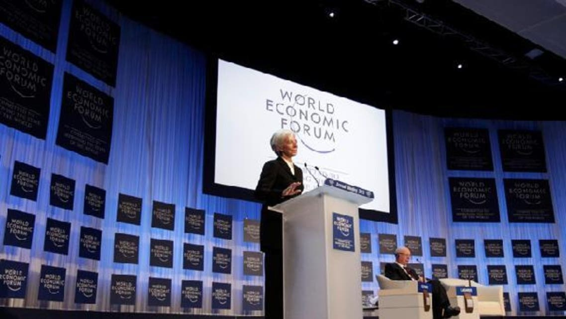 International Monetary Fund (IMF) chief Christine Lagarde addresses the annual meeting of the World Economic Forum (WEF), next to WEF founder Klaus Schwab (R), in Davos Jan. 23, 2013. (Reuters)