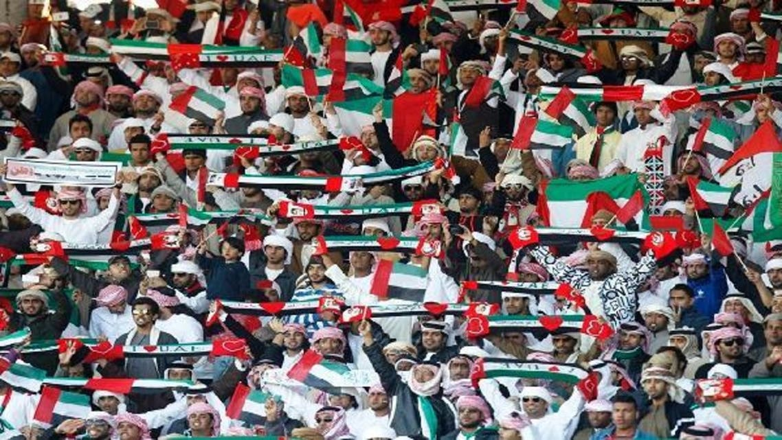 UAE fans cheer their team during their match against Kuwait at the Gulf Cup Tournament semi-final soccer match in Isa Town, Jan. 15, 2013. (Reuters)