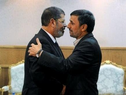 محمود أحمدي نجاد ومحمد مرسي