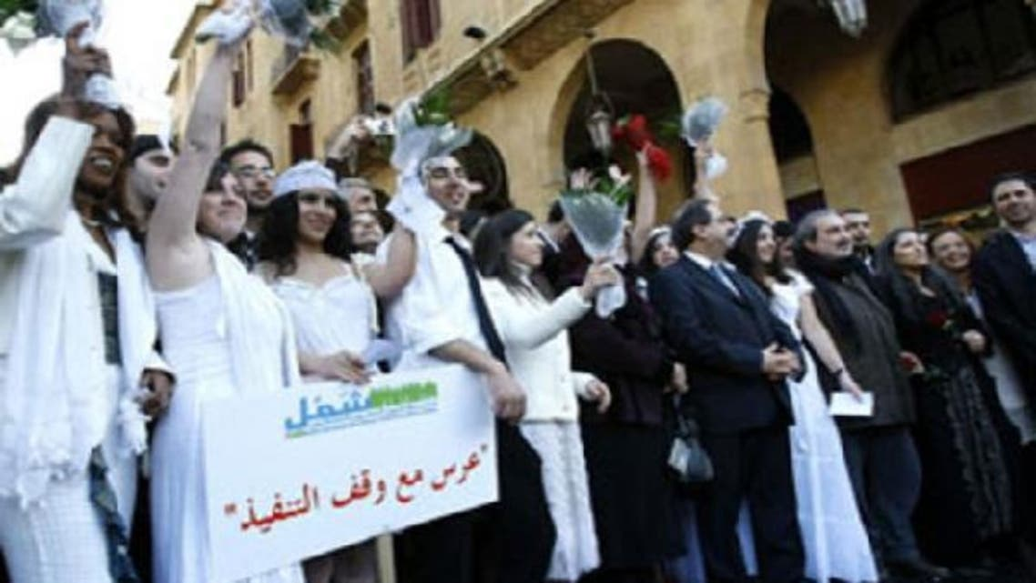 Lebanese activists take part in a mock wedding as part of a campaign demanding the legalisation of civil marriages. (AFP)