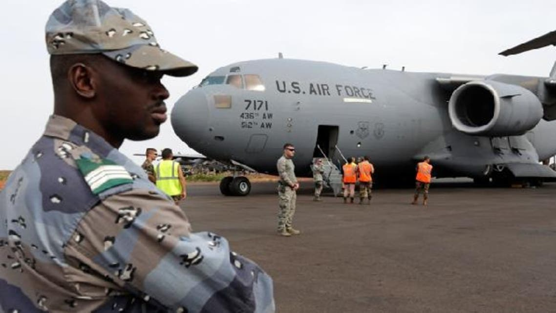 A Malian gendarme stands guard after the arrival of a U.S. Air Force C-17 transport plane with French troops at the airport in Bamako Jan. 22, 2013. The United States has started transporting French soldiers and equipment to Mali as part of its logistical aid. (Reuters)