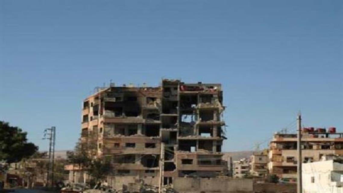 داریا میں شامی فوج کی بمباری سے تباہ شدہ ایک عمارت