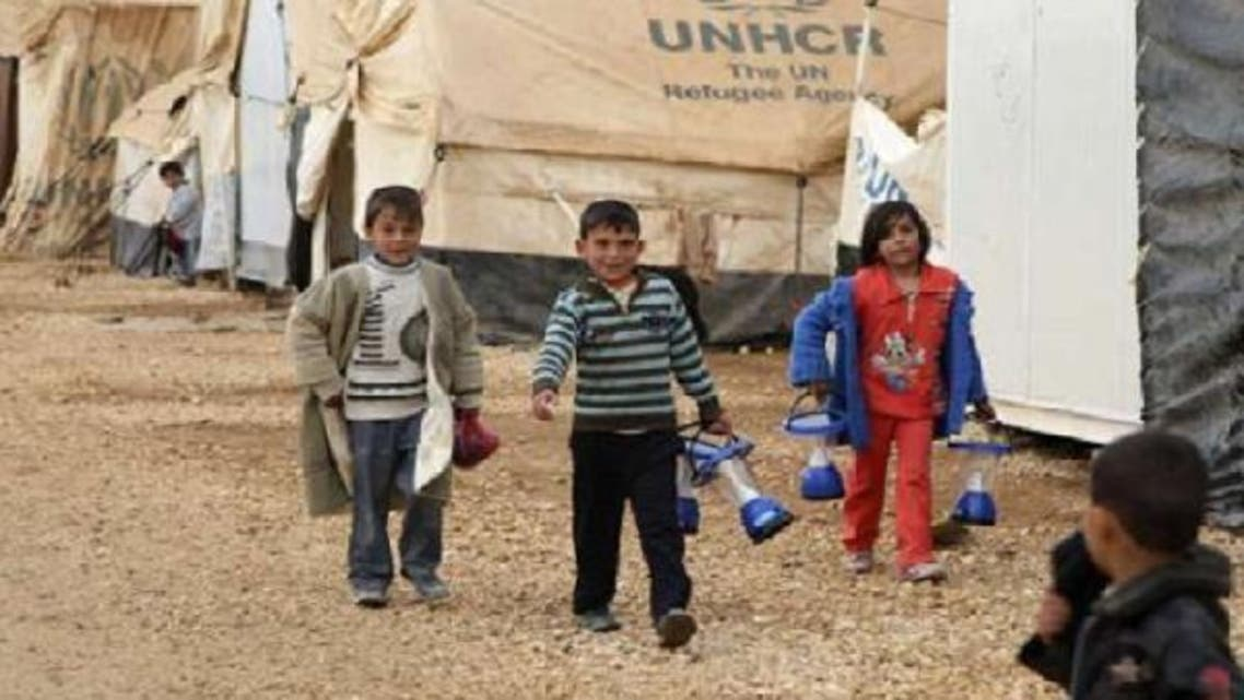 Syrian refugee children walk at Al-Zaatari refugee camp in the Jordanian city of Mafraq, near the border with Syria. (Reuters)
