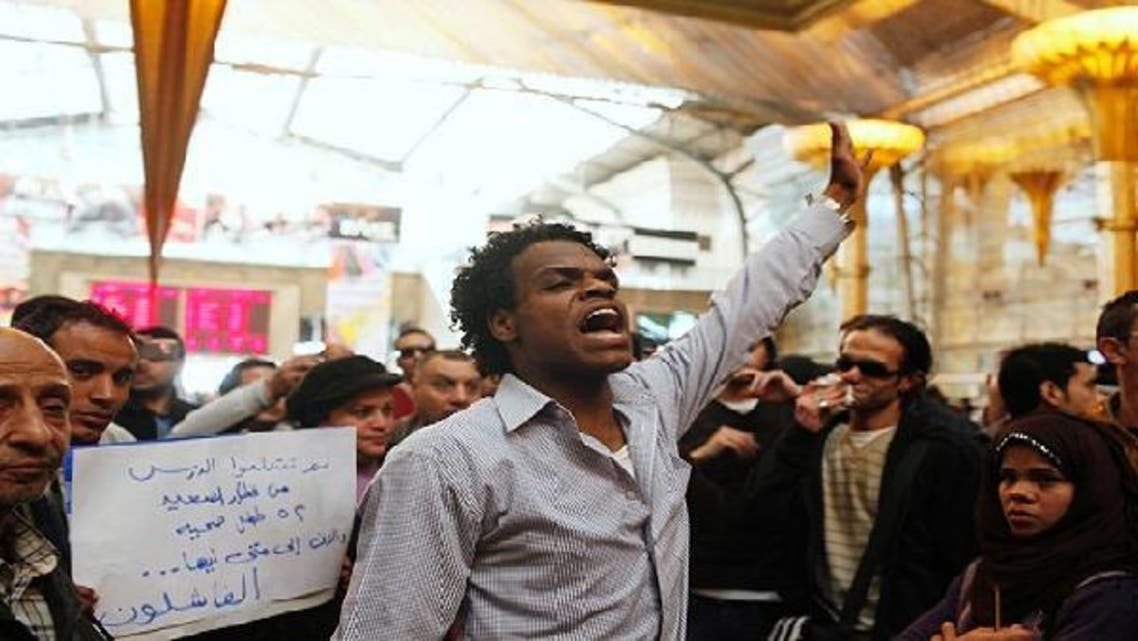 Protesters chant anti-Muslim brotherhood slogans blaming them for the train crash of Badrashin, at the main rail ways station in Cairo, January 15, 2013. A military train carrying young recruits to an army camp derailed in a Cairo suburb on Tuesday, killing 19 people and injuring 107. (Reuters)