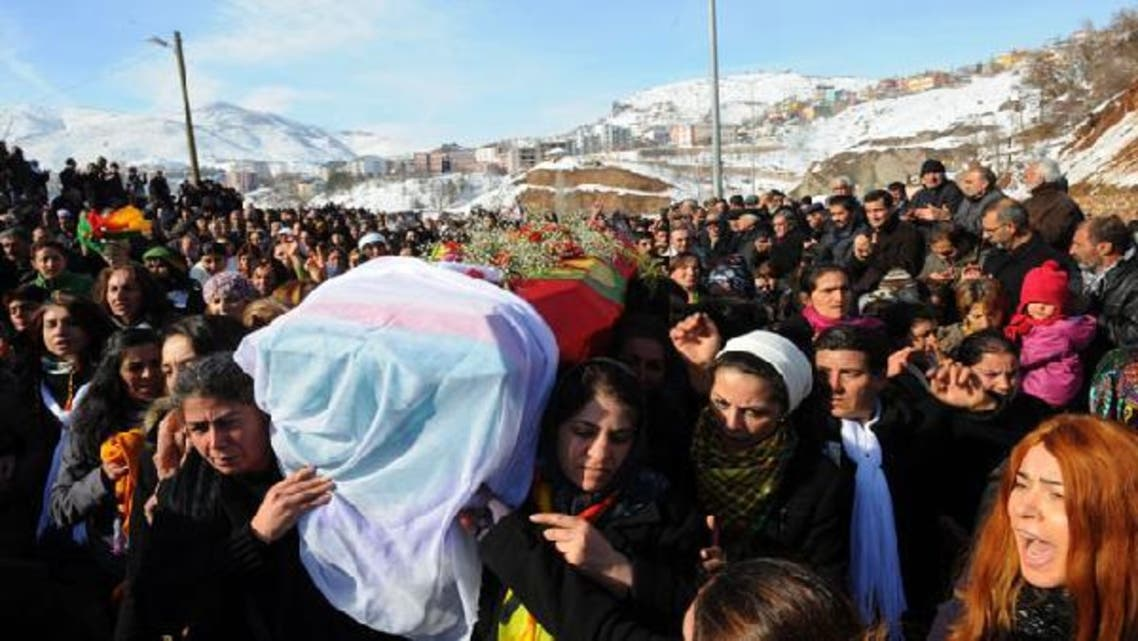 People carry the coffin of the Kurdish activist Sakine Cansiz, shot dead in the French capital, on January 18 in Tunceli. (AFP)