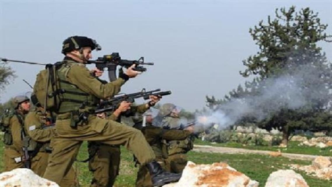 Israeli soldiers fire tear gas canisters at Palestinian protestors during a demonstration in the West Bank village of Budrus, on January 18, 2013. (AFP)