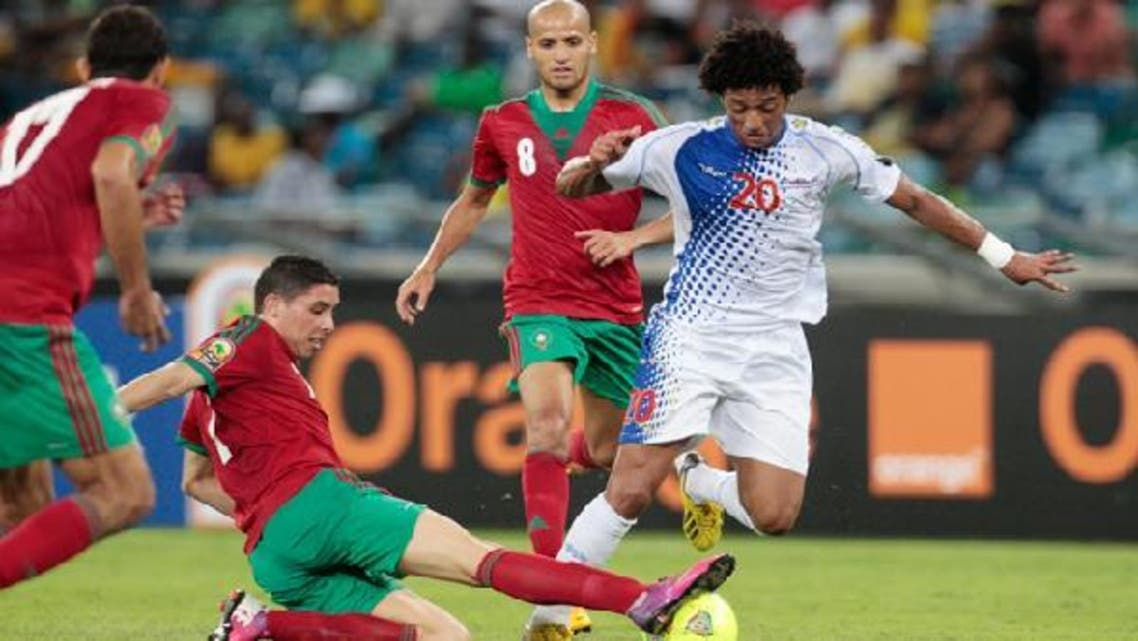 Cape Verde's Ryan Mendes (R) dribbles the ball past Morocco's Issam El Ado (L), Abdelaziz Barrada and Karim El Ahmadi (2nd R) during their African Nations (AFCON 2013) Cup Group A soccer match in Durban Jan.23, 2013. (Reuters)