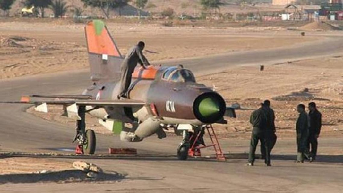 A Syrian air force Russian-made MiG-21 plane that a pilot landed with in the King Hussein military base in Mafraq in northern Jordan on June 21, 2012. (AFP)