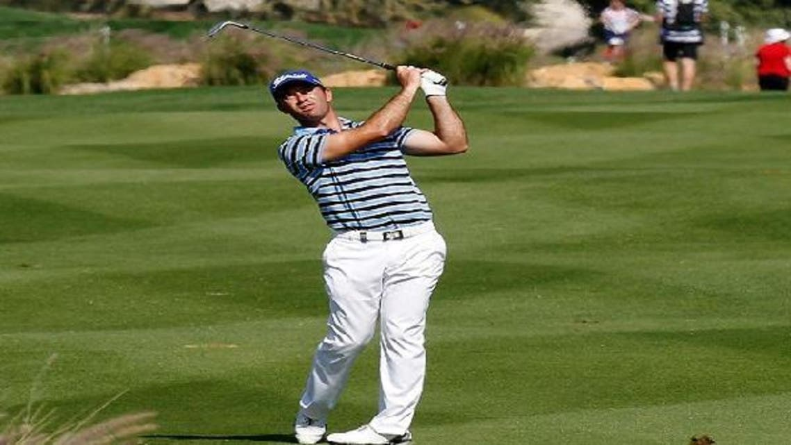 Ricardo Santos of Portugal plays a shot at the 17th during the first round of the Commercial Bank Qatar Masters at the Doha Golf Club Jan. 23, 2013. (Reuters)