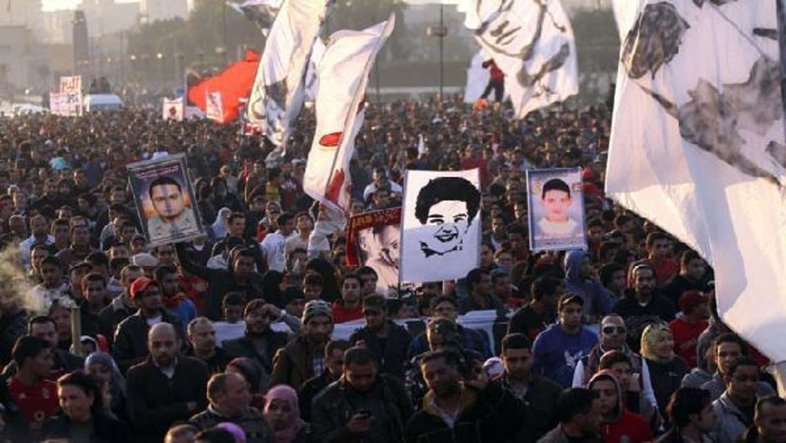 Egyptian al-Ahly football club ultras and protesters hold portrait of the victims the 2012 Port Said football match killings, during a demonstration demanding justice for the victims one week ahead of a court ruling on the matter, in Cairo\'s Tahrir square on January 18, 2013. (AFP)