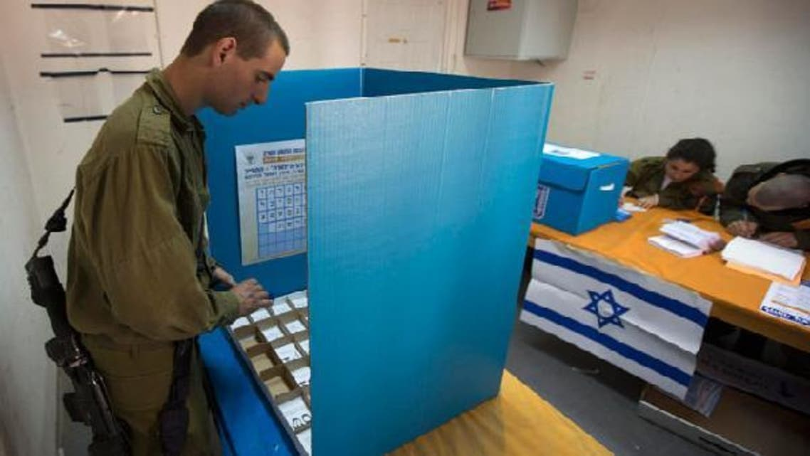 An Israeli soldier casts his ballot at a polling station in a military base in southern Israel January 21, 2013. Israeli soldiers started voting in Israel's parliamentary election on Sunday. Polling stations for the rest of Israel open on Tuesday. (Reuters)