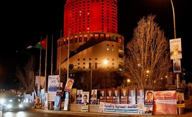Cars drive past parliamentary election campaign posters in central Amman January 22, 2013.  (Reuters)