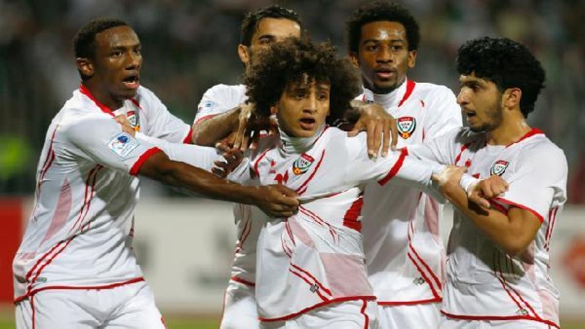 UAE's players celebrate their goal during their Gulf Cup Tournament final soccer match against Iraq in Isa Town, Jan. 18, 2013. (Reuters)