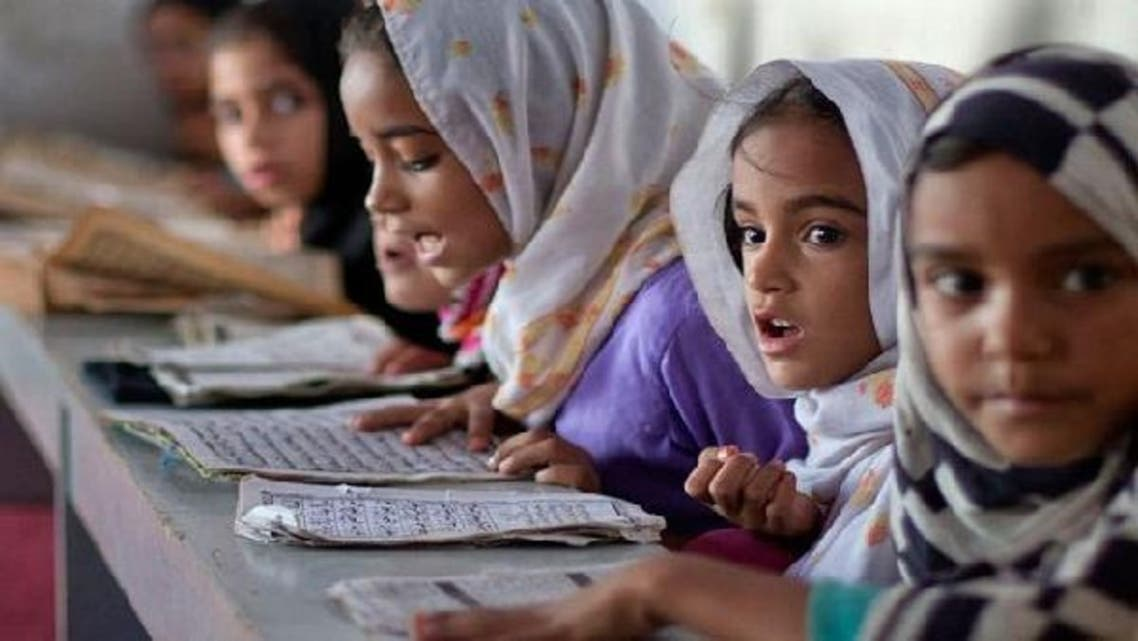 Two female students in Pakistan are designing hijabs and abayas for the increasing numbers of girls turning towards the practice of veiling. (Reuters)