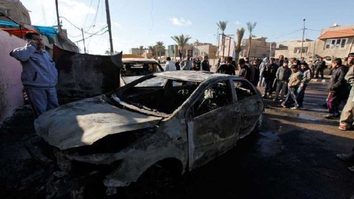 At least three people die and 14 are wounded in car bomb attack targeting civilians in Baghdad. (Reuters)