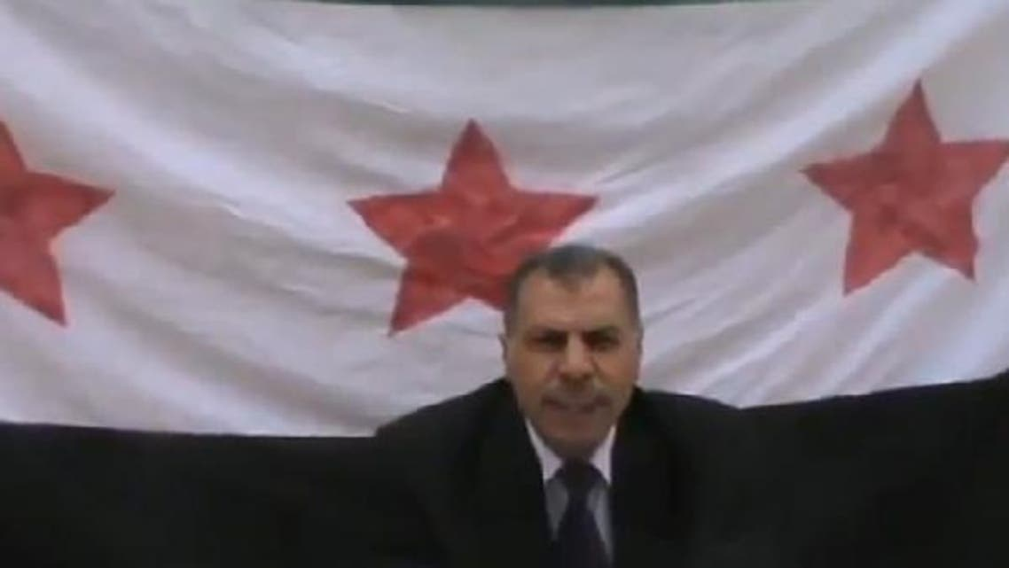 An image grab of a YouTube video showing a senior foreign intelligence official announcing his defection. (Courtesy of Free SyrRev)