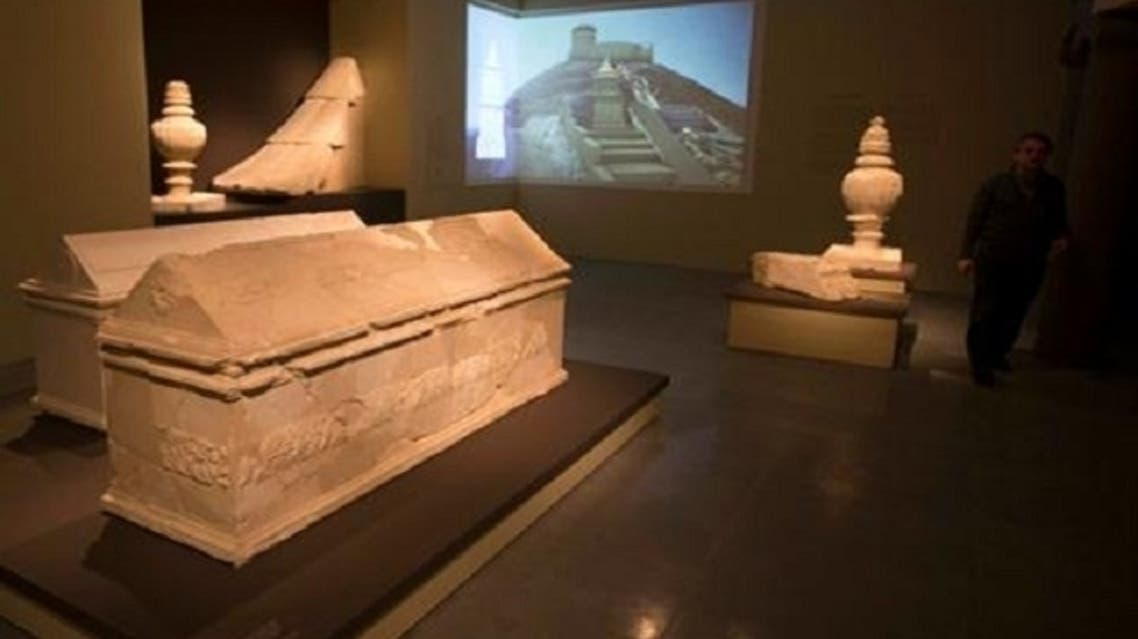 """A man walks near sarcophagi during a media preview of an exhibition titled """"Herod the Great: The King's Final Journey"""" at the Israel Museum in Jerusalem Feb. 12, 2013. (Reuters)"""