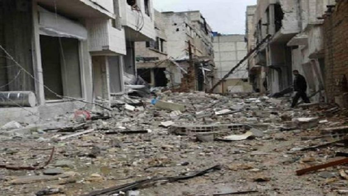 A man walks near buildings damaged by what activists said were missiles fired by a Syrian Air Force fighter jet loyal to President Bashar al-Assad in Erbeen, near Damascus, in a picture provided by Shaam News Network Jan. 6, 2013. (Reuters)