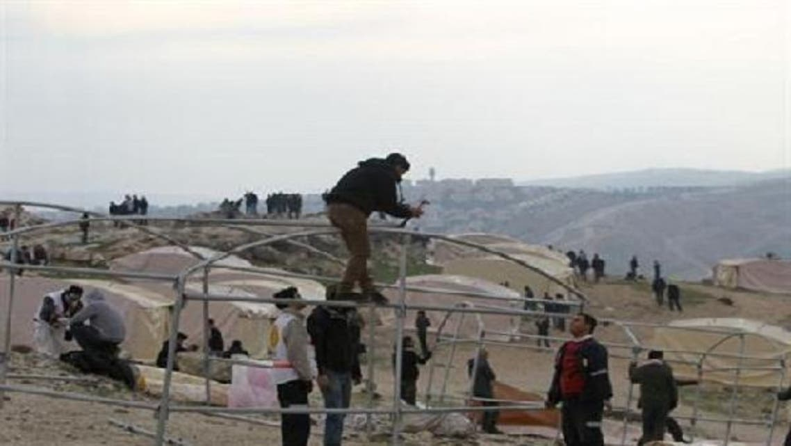 """Palestinian activists set up on Jan. 11, 2013 an \\""""outpost\\"""" named Bab al-Shams (\\""""gate of the sun\\"""") in the Israeli-occupied West Bank, between Jerusalem and the Jewish settlement of Maale Adumim, in an area Israel said it would build thousands of new settler homes. (AFP)"""