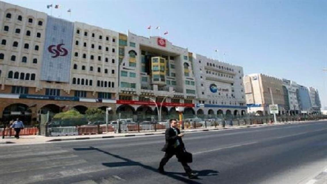 A man crosses Grand Hamad street, where banks and financial institutions are located, in Doha, Qatar. (Reuters)