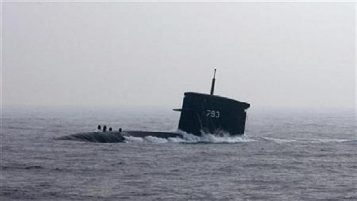 A U.S. submarine\'s periscope strikes a vessel in the Gulf on Thursday. (Reuters)