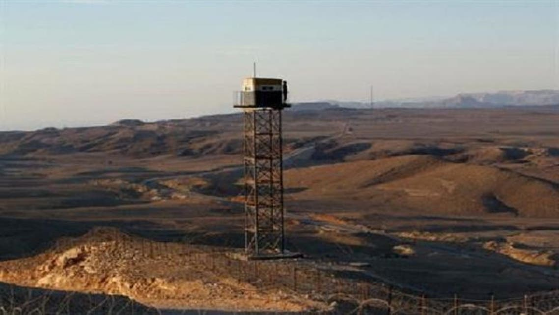 An Egyptian soldier stands guard on a watchtower on the border between Israel and Egypt, some 30 km north of Eilat. (Reuters)