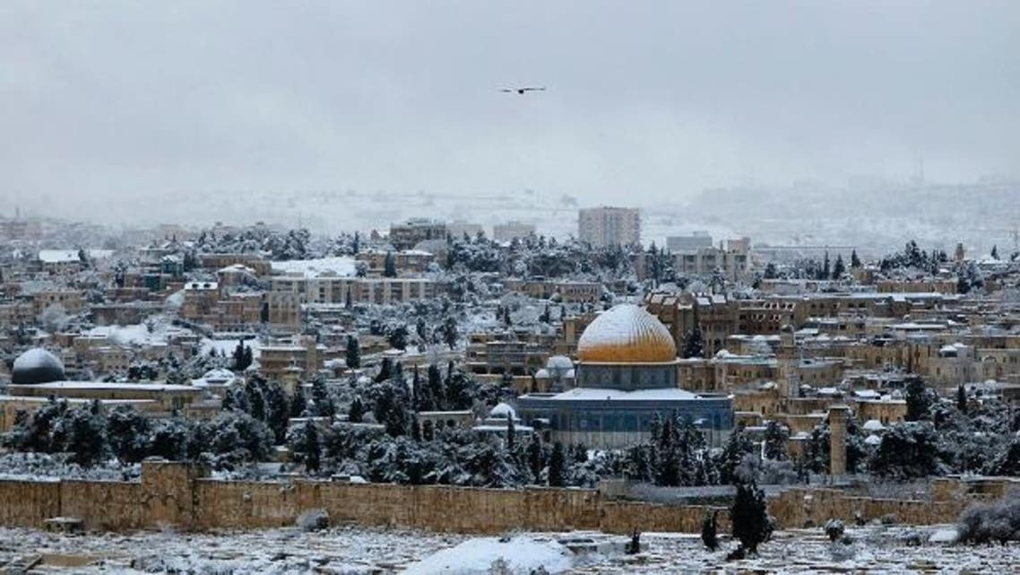 A bird flies over a snow-covered Dome of the Rock in Jerusalem's Old City on Jan. 10, 2013. The worst snowstorm in 20 years shut public transport, roads and schools in Jerusalem on Thursday and along the northern Israeli region bordering on Lebanon. (Reuters)