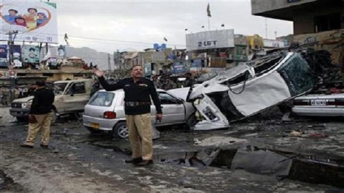 A police official gestures at the scene of a bomb explosion in Quetta on Jan. 10, 2013. (Reuters)