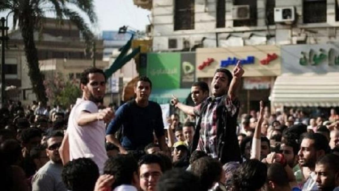 Egyptians protest against a controversial new law that allows the army to court-martial civilians. Mohamed Sabry, a freelance video journalist and activist, was recently arrested under the law. (AFP)