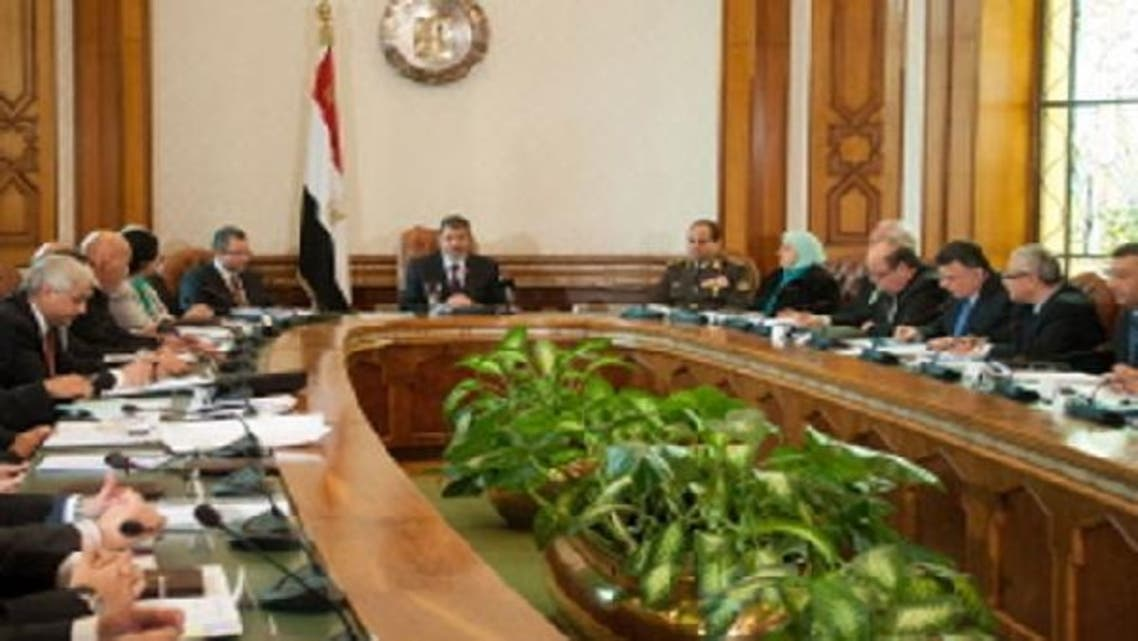 Egyptian President Mohamed Mursi (C) meeting with the Cabinet in Cairo on Jan. 6, 2013. (AFP)