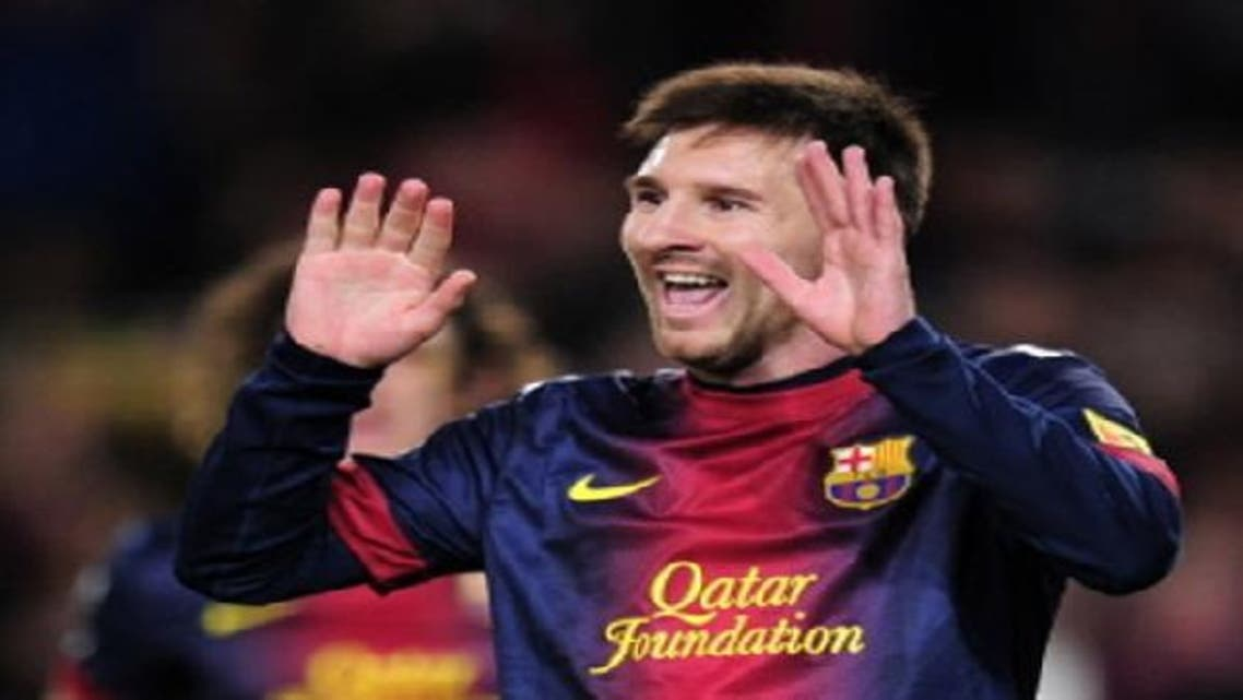 Barcelona\'s Argentinian forward Lionel Messi celebrates after scoring a goal during the Spanish league football match FC Barcelona vs RCD Espanyol . (AFP)