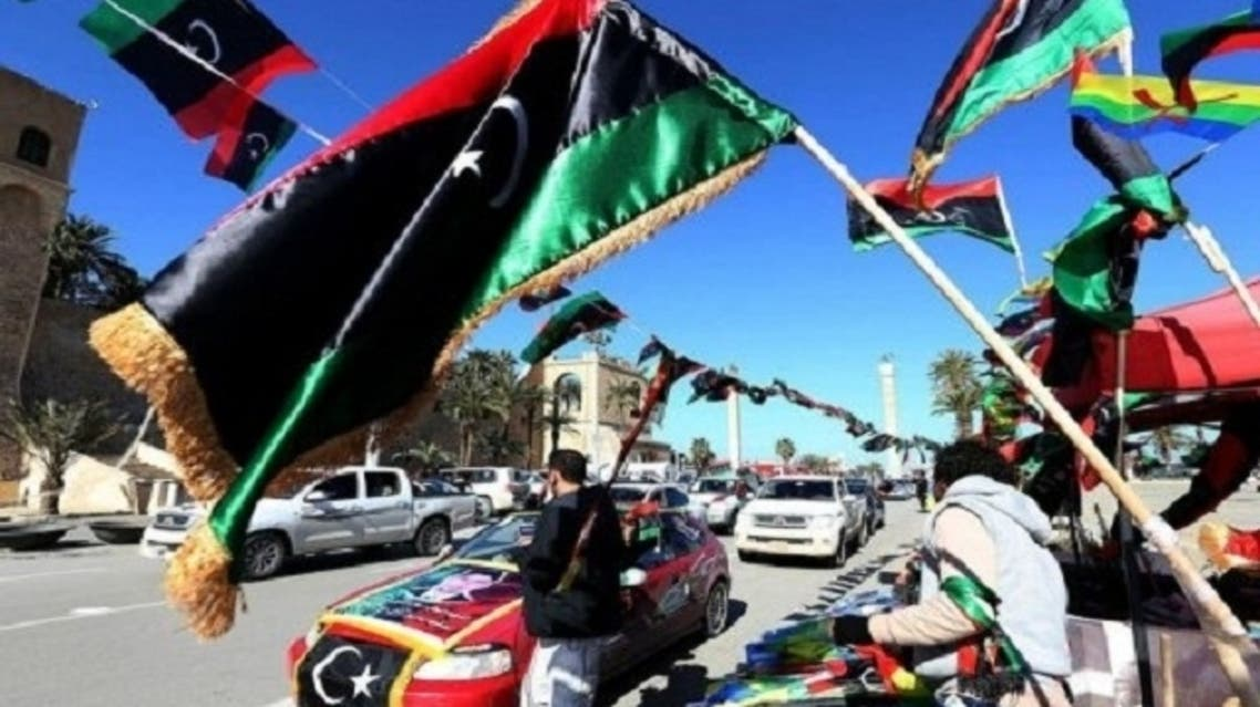 A Libyan street vendor sells national flags near the Martyrs square, two days ahead of the second anniversary of the uprising. (AFP)
