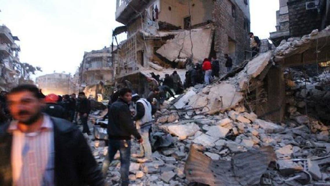 Men search for survivors under rubble after a missile hit Aleppo\'s al-Mashhad district January 7, 2013. (Reuters)