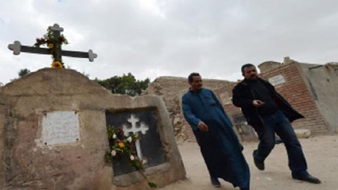Egyptian Coptic Christian men walk at a cemetery on January 6, 2013 in the historical part of Cairo. The Copts of Egypt will celebrate on Jan. 7, 2013 their first Christmas since the country has been ruled by Islamists in a climate of concern despite assurances from the authorities. (AFP)